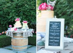 three cakes with coral peonies on top, sitting on a wine barrel table