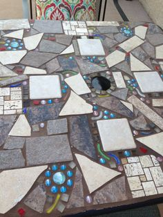 Mosaic table from scrap tiles.
