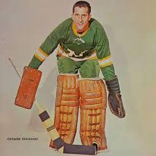 Résultats de recherche d'images pour «cesare maniago hockey player» Maurice Richard, Minnesota North Stars, Toronto Maple Leafs, Hockey Players, Winter Jackets, Images, Sports, Mens Tops, Fictional Characters