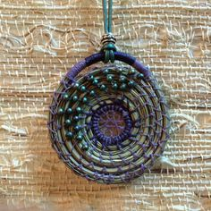 Pendant made from pine needles. Yes your read by Sheripineneedle
