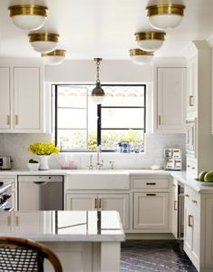 Cute kitchen, and not too big. Love the black Moroccan tiles! Those weird overhead lights, not so much,