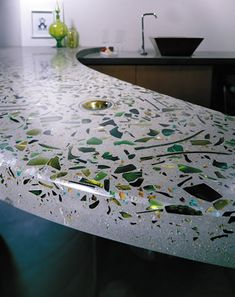 green embedded glass in concrete countertop