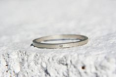 Thin delicate 14k white gold square stacking band set.