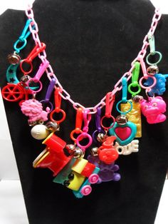 You know you were an 80's kid if you remember how utterly awesome these were.  80s Pink Plastic Charm Necklace with Charms and  by TinkrGems, $37.00