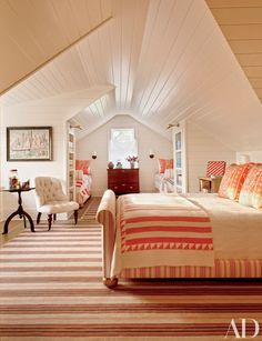 In the guest bedroom, a 19th-century striped quilt covers the bed in the foreground | archdigest.com