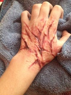 Cut up hand sfx makeup gelatin prosthetic Up Halloween Costumes, Scary Costumes, Halloween Makeup Looks, Halloween Make Up, Horror Makeup, Scary Makeup, Zombie Pub Crawl, Spx Makeup, Theatrical Makeup