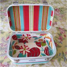 Vintage suitcase relining. Use aluminum foil on the inside to get a pattern cutout!