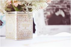 vintage English tea tins as centerpieces, framed engagement photos, rustic vintage chic wedding, rustic vintage Vermont wedding