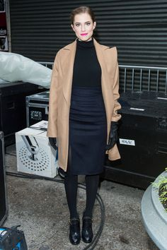 Who: Allison Williams What: The Camel Coat Why: A camel coat is the perfect topper for almost anything, but when paired with the classic turtleneck-and-pencil-skirt combo, it lends the air of a Hitchcockian heroine. A pink lip adds a modern touch. Get the Look Now: MSGM coat, $798, thecorner.com. Getty Images  - HarpersBAZAAR.com