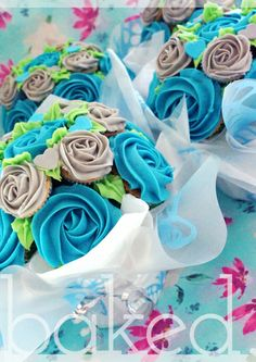 Cupcake Bouquets in blue and silver from Baked Cupcakery. Great wedding table centre pieces.