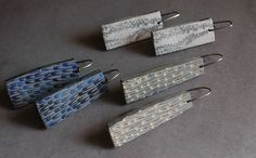 Seabed and Feather textured earrings by jibby and juna, via Flickr
