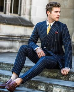 Pin stripe suit, vintage gold tie and burgundy loafers.
