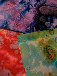 marbleized paper with canola oil and food coloring.
