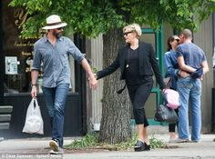 New love and love that's lasting in one picture. [In the forefront it's Hugh Jackman holding hands with his wife of 18-years, Deborra-Lee Furness in New York City.]