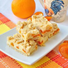 Apricot Orange Cheesecake Bars - a freezer friendly recipe with the delicious combination of dried apricots in a citrus flavored cheesecake surrounded by buttery shortbread crumble. Cheesecake Bars, Cheesecake Recipes, Cookie Recipes, Dessert Recipes, Just Desserts, Delicious Desserts, Raisin Cake, Muffins, Biscuits