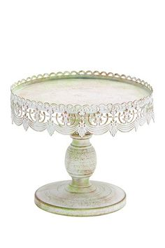 """Rustic Vintage Furniture  Metal Cake Stand - Antique White  This beautiful cake stand will add shabby-chic appeal to your kitchen counter.   - Rust finish  - Color: antique white  - Approx. 10"""" W x 9"""" H  Retails for $48.00  The finish on this cake stand wasn't very attractive.  I spray painted it white and it looks 10x better."""