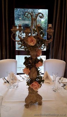 Blush rose tall candelabra table centrepiece at The Alicia Hotel