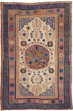 A Samarkand rug BB4393 - An early 20th century Samarkand (Khotan) rug, the oatmeal field with flowering branches and rosettes and a central ...