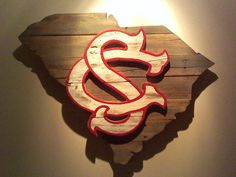 Handcrafted wooden state of South Carolina with USC logo made from pallet wood. Dimensions - The products displayed on this South Carolina Homes, University Of South Carolina, South Carolina Gamecocks, Gamecocks Football, Football Signs, College Football, Palmetto Tree, Wood Pallets, Badges