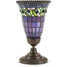 The hand made Tiffany stained glass uplighter shade is in iridescent blueish purple with a border of green leaves decorated with beads. The top of the shade is also decorated with a beaded border. Light Table, Lighting Collections, Energy Bulbs, Stained Glass Light, Lamp, Decorative Borders, Stained Glass, Stained Glass Table Lamps, Period Lighting