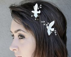 """50 Unique Wedding Hair Accessories From Etsy: The beach bride could add seashell bobby pins ($25) to her cascading waves. : Forgo a traditional veil with this bridal flower headband ($120). : A nontraditional bride should go for something playful like a peacock hair comb ($25), which could also serve as your """"something blue."""" : This pair of love-bird bobby pins ($32) lends a romantic touch."""