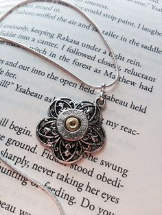 Silver flower Winchester 45 caliber bullet pendant by Myparttime