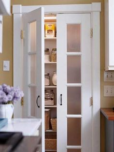 Kitchens Frosted-Glass Pantry Doors-  obscure what's inside so the pantry doesn't have to be kept tidy. Plus, the doors add a light and bright element to the kitchen.