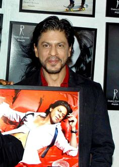 Shah Rukh Khan poses with his picture for Daboo Ratnani's 2014 Calendar.