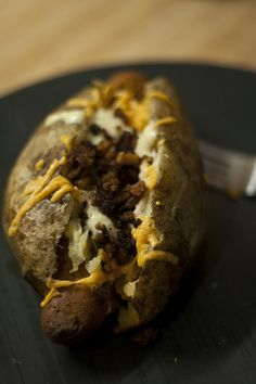 Vegan tater pigs!  Tater pigs are hollowed out baking potatoes with a sausage in them, then they're dressed like a normal baked potato.
