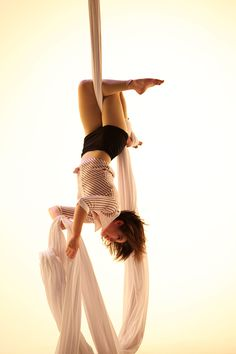 Casually hanging out. Aerial silk ( just footlock, cross legs and lay back? Looks fun and beautiful )