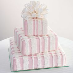 Lavish Gifts Cake - Squares prove to be as gifted in sophisticated settings as more gracefully-curved shapes. The lines of this package design are softened by the scalloped and scrolled ribbons and a fluffy top bow of rolled fondant. Gift Box Cakes, Gift Cake, Creative Wedding Cakes, Creative Cakes, Unique Cakes, Elegant Cakes, Cupcakes, Cupcake Cakes, Fondant Cakes