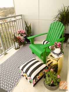Behr's Chorophyll looks fantastic on this wooden Adirondack Chair, especially when paired with black and white accents!   From The Home Depot Patio Style Challenge and Mandy of Fabric Paper Glue