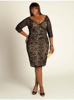 Justine Lace Dress in Black/Nude The Justine Dress offers a fresh, feminine cocktail frock with a plunging scallop-trimmed neckline and curve defining, faux-wrap silhouette. Play up this dreamy dress with classic styling—a pale pink lip, an upswept hairstyle, and antique diamond earrings will enhance a polished presentation.