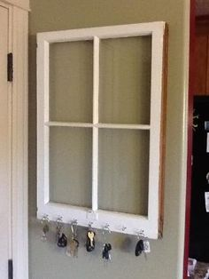 Use an old window as a dry erase board (with hooked added for keys like this one, if located in your mudroom or near your door) - I love the concept of repurposing old windows, especially if they look a bit distressed, and this is a great idea. Excellent for getting organized too! by juliana