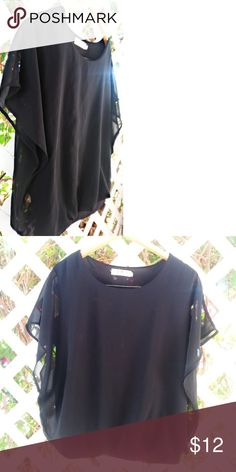 Beautiful black Blous BUY1GET1FREEonEVERYthing In great condition runs smaller then 2x   buy one get one free items must be equal or less value   bundle your items and let me know when your done so I can send you an offer with discounted shipping classic fashion Tops Blouses