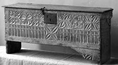 From about 1530 tudor style furniture began to come under the influence of Italian Renaissance styles and this saw the use of more carving and ornamentation. Traditional gothic linenfold, Tudor Rose, and other designs derived from architecture saw themselves being mixed with Italianate garlands and profile heads in roundels.