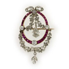 An Edwardian ruby and diamond laurel swag pendent, set with an old pear shape-cut diamond, weighing approximately 0.75 carats, dropping by a rose-cut diamond-set floreal composition, to the centre of a calibre ruby-set oval, all set to a yellow gold mount with brooch fitting, comprising four millegrain-set old round brilliant-cut diamonds and including a rose-cut and old round brilliant-cut diamond-set bow to the top and a floreal composition to the bottom, all set in platinum, circa 1900.