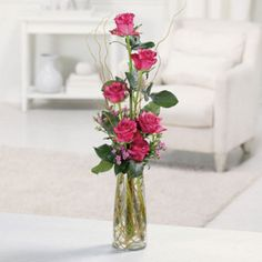 Sending thoughtful greetings and warmest regards, a half-dozen roses with waxflower and curly willow brings a whole lot of joy. *Contents may vary *Container may be substituted with one of equal value