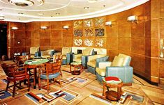 RMS Queen Elizabeth - 1939 - After Refitting ~ The Cabin Class ~ The Smoke- Room also received countless changes, new carpets and new leather chairs and the feature seen here It certainly became a wonderful looking venue indeed; in fact it looked more like a First Class lounge!