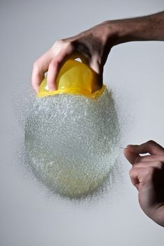 High speed photography of a water balloon being popped.  Just plain cool. By Edward Horsford