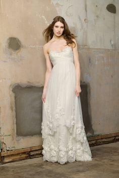 this is such a whimsical and romantic dress! i just love it. especially the detail of the cascading overskirt. omg.