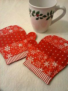 Set of 2 Celebrate the holidays and the winter season with this fun pair of mittens mug rugs/coasters featuring pretty snowflake fabric in red, green, or blue. (Other colors available upon request, though they may not feature snowflakes.) Size: Approx. 6.5 x 5.5 Made in my smoke free/pet free home. Custom orders welcome. :)