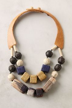 Anthropologie - Woven Baubles necklace - Button closure - Straw, snakeskin, wood