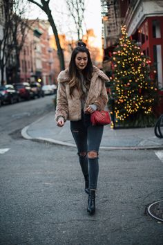 Winter Faux Fur | Thrifts and Threads. Grey swetar+grey ripped skinny jeans+black ankle boots+brown fur jacket+red crossbody bag. Winter Casual Outfit 2017