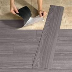 For the basement bedroom Peel-And-Stick Wood-Look Plank Flooring |$24.00 15 sq. ft.