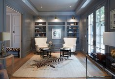 Los Angeles Home with East Coast Inspired Interiors - The study carries a more sophisticated feel with this choice of paint color. I love the zebra rug and the brass lighting. ◆The color of this room is gorgeous!◆