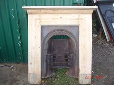 """CAST IRON FIREPLACE WITH ORIGINAL PINE FIRE SURROUND ~ can make a new """"mantel"""" around my cast iron surround to build it in over the sink in the laundry room..."""