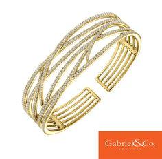 Gorgeous 14k Yellow Gold Diamond Bangle by Gabriel & Co. that is a must have! This beautiful bangle is so amazing with all its designs and diamonds. Find your local Gabriel & Co. retailer at our website www.gabrielny.com