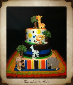 Jungle themed baby shower cake! All fondant- Flavors include Dominican cake filled with dulce de leche cream filling for bottom and middle tier; and dominican cake filled with Bavarian cream filling for top tier. Cake decorations include fondant jungle animals, and trees made out of piped chocolate.  Funcakes & More - ( Ana Tejeda) Feel free to re-pin!! :D  Thanks for looking!!
