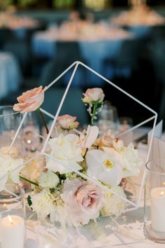 """From the editorial, """"This Modern City Wedding In Melbourne Pulls Out All The Stops"""". We're swooning over this elevated reception with dramatic chandeliers. 